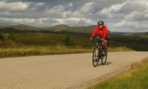Barbara cycling to John O' Groats